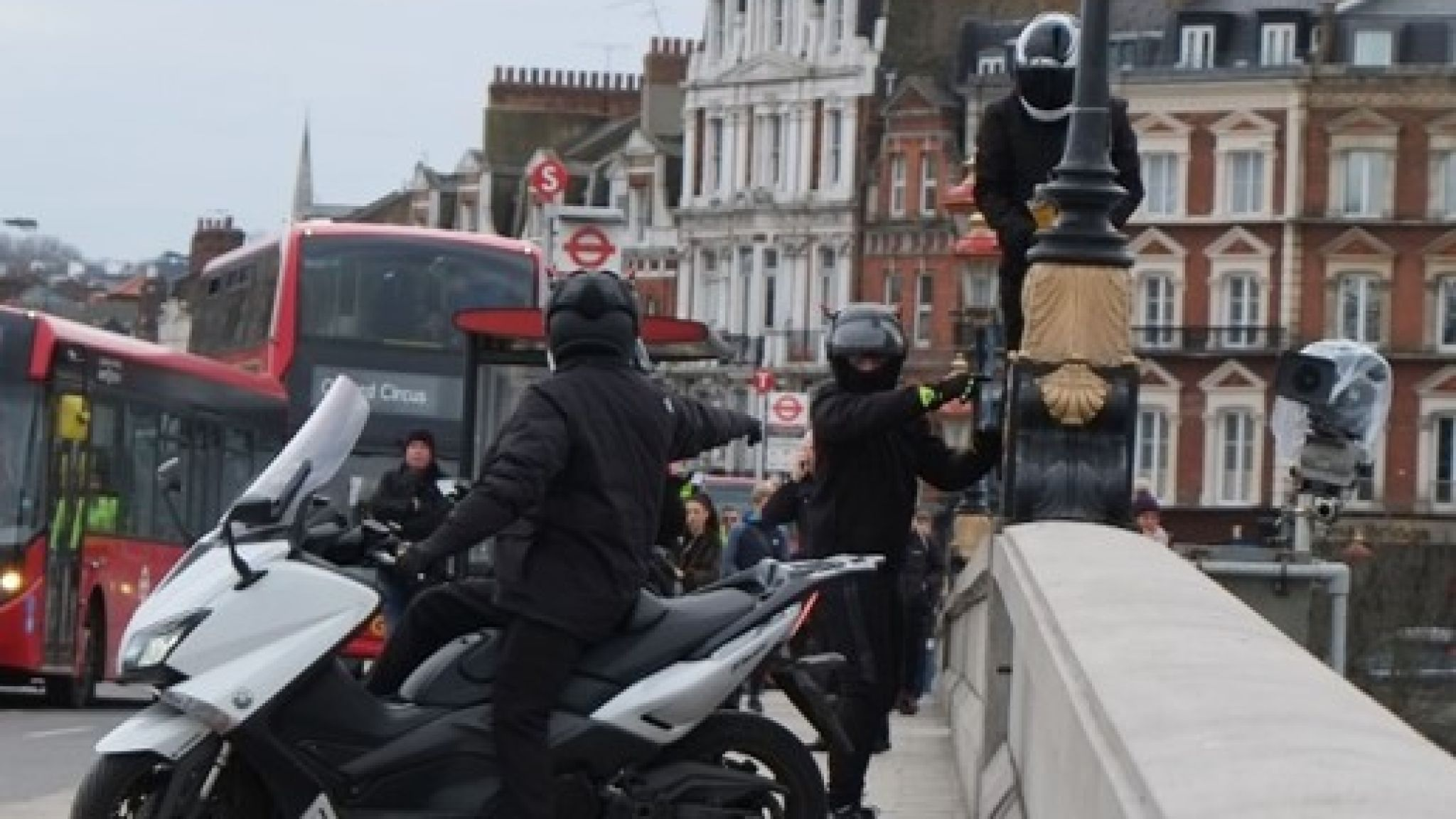 Moped stop traffic and attempt to steal cameras estimated to be worth £180,000